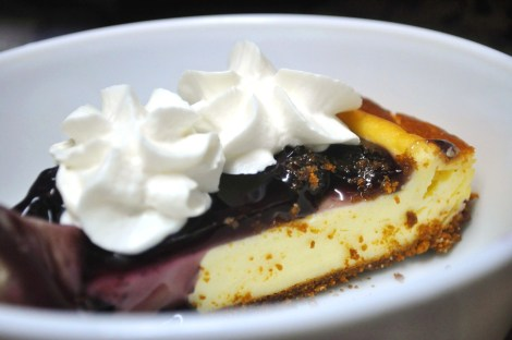 Blueberry Cheesecake topped with Whipped Cream