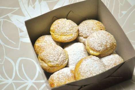 Dust the filled cream puffs with icing sugar for a polished look