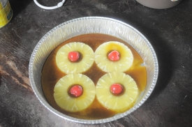 Arrange the pineapple slices and cherries