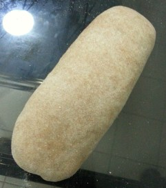 A third of the recipe has been shaped into a 6-inch long loaf. You can choose to make bigger loaves by using half of the recipe for each one. This will be allowed to rest and rise for another 30 minutes before baking.