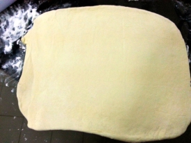 Roll the dough out to 1/3 in thick
